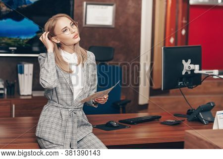 Business concept. Portrait of a beautiful modern business woman working in the office. Successful women in business.