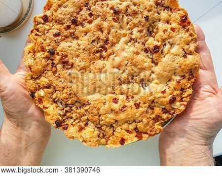 Delicious Homemade Fresh Pie In The Hands Of An Old Woman. Close-up, Top View Of The Hand, Ready Del