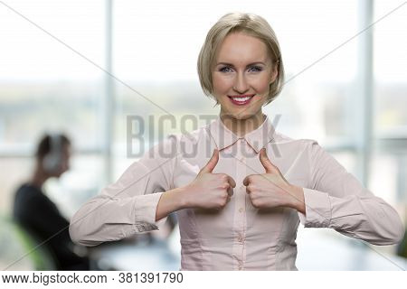 Business Woman Showing Thumbs Up To Camera. Beautiful Business Lady Looking At Camera With A Smile.
