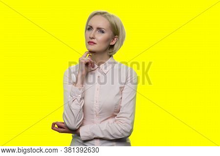 Beautiful Young Business Woman With Thoughtful Expression. Pensive Business Lady With Hand Under Chi