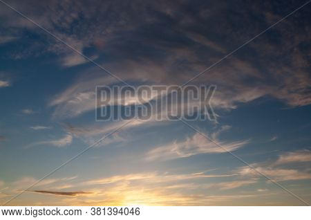 Feathery Clouds In The Evening Sky