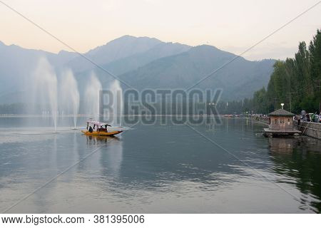 Fountains Over The Dal Lake With Mountains In The Background, At Dusk. Dal Lake Is The Most Famous L