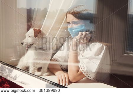 Sad Young Woman In Medical Mask With Dog Jack Russell Broken Stay Isolation At Home For Self Quarant