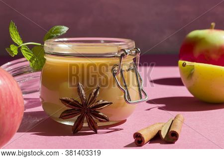 Fresh Organic Homemade Applesauce, Mousse, Sauce In A Glass Jar On A Pink Background. Healthy Natura