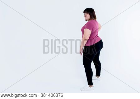 Asian Fat Woman Which Puts Using Left Hand On The Hips Which Is Large And Full Of Excess Fat On Whit