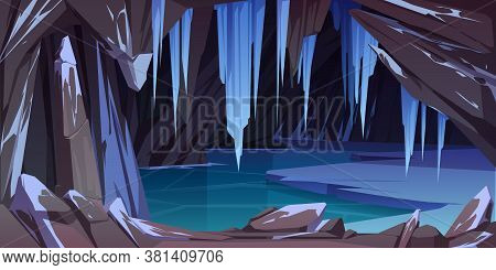 Ice Cave In Mountain, Grotto With Frozen Lake And Hanging Icicles Inside. Empty Cavern, Nature Lands