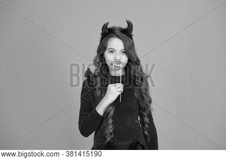 Vampires Are Real. Vamp Girl. Little Girl Wear Red Devil Horns And Vampire Teeth. Small Girl With Ha