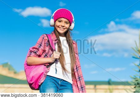 Your Own Learning Center. Happy Child Listen To Music Sunny Outdoors. Audio Learning. Listening Comp