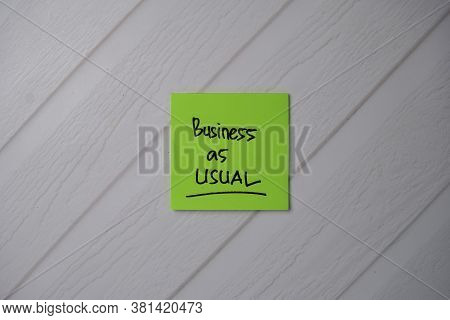 Business As Usual Text On Sticky Notes With Office Desk.
