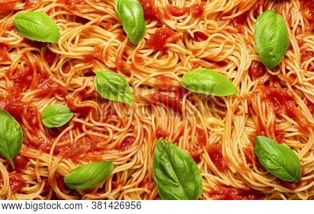 Spaghetti Cooked With A Traditional Tomato Sauce And Green Leaves Of Basil. Above View With Cooked S