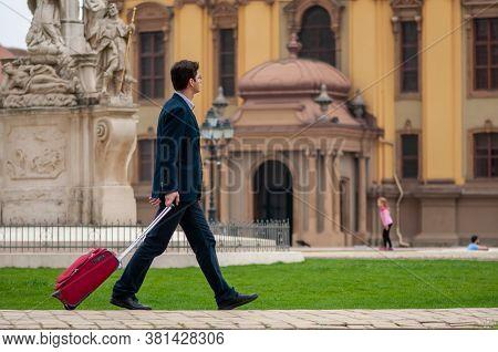 Timisoara, Romania - April 09, 2016: Man Walking On The Street. Man In Business Suit Carrying His Lu