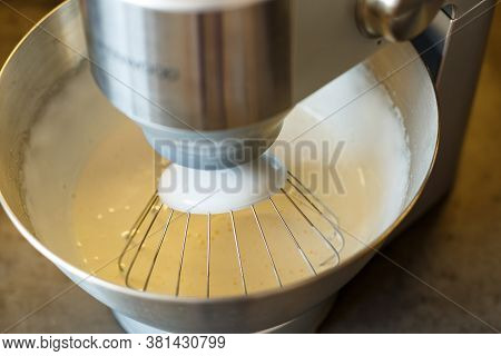 Beating Cream For A Sweet Dessert In A Food Processor. Cream Nozzle