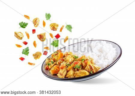Curry Chicken With Rice In A Plate On A White Isolated Background
