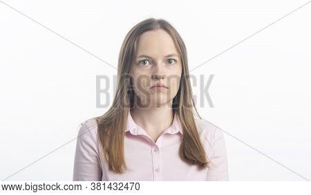 Mistrust And Puzzled Young Woman, Looking At Camera. Studio Shot