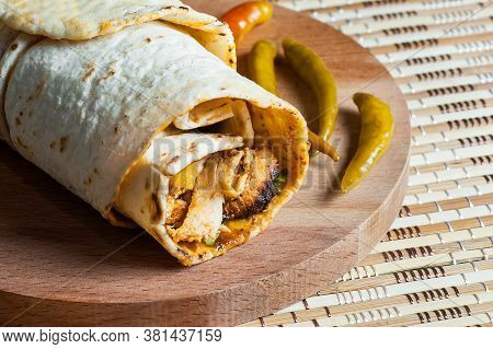 Chicken Wrap Doner Kebap In Lavash Pita Bread Durum With Thin Green Pepper Pickle On Wooden Platter.