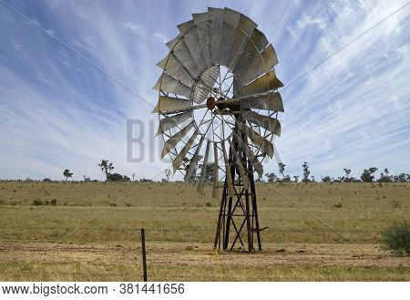 Australian Windmill In The Outback Of Queensland Australia
