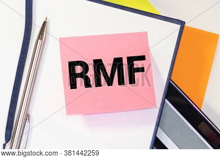 Businessman Hand With Pen Pointing To Rmf Sign On The Paper.