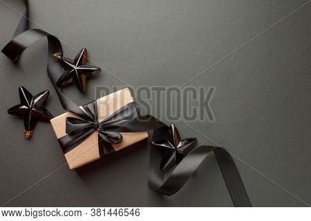 Beautiful Minimal Christmas Golden Black Decor And Paper Craft Gift Box With Satin Black Ribbon On D