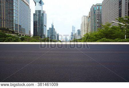 Empty Road Surface Floor With City Landmark Buildings