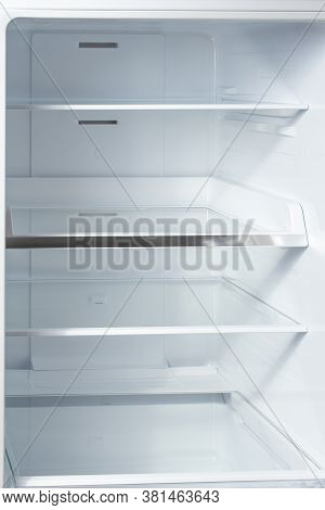 Clean Empty Shelves In White Refrigerator. Empty Open Fridge With Shelves, Refrigerator. Shelves In