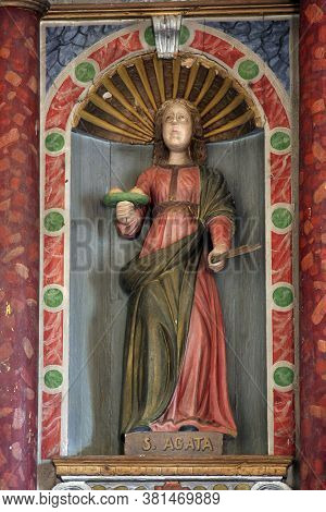 BACVA, CROATIA - MAY 31, 2013: Saint Agatha, a statue on the main altar in the parish church of Our Lady of Mount Carmel in Bacva, Croatia