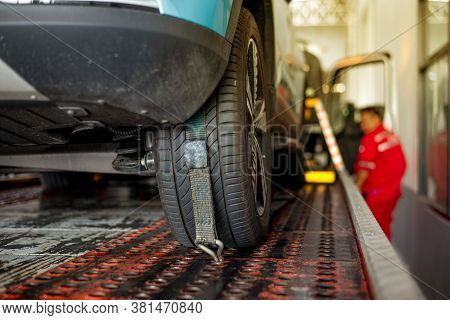 Tow Truck Towing A Broken Down Car On The Service Center Repair Loading Broken Car On A Tow Truck On