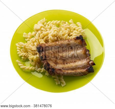 Grilled Pork Ribs With Pasta. Grilled Pork Ribs On A Lime Plate Isolated On White Background. Grille