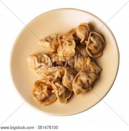 Dumplings On Light Brown Plate Isolated On White Background. Dumplings In Tomato Sauce. Dumplings To