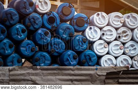 Selective Focus On Empty Old Chemical Barrels. Blue And White Oil Drum. Plastic Oil Tank. Toxic Wast