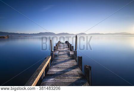 Wooden Pier Or Jetty And Lake At Sunrise. Torre Del Lago Puccini, Versilia, Massaciuccoli Lake, Tusc