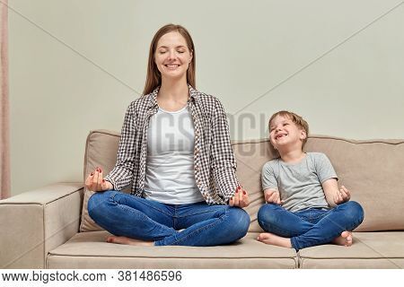 A Young Mother Teaches Her Child How To Meditate Correctly.