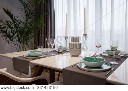Family Event Concept. Contemporary Interior Design In Kitchen At Modern House With Plate, Silverware