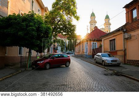 Uzhhorod, Ukraine - Jun 04, 2017: Empty Street Of The Old European Town At Sunrise. Sun Behind Greek