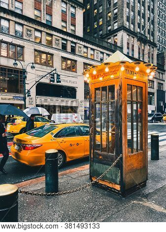 New York City, Usa - February 11, 2020: Old Fashioned Yellow Taxi Cab Booth On 42nd Street Near Gran