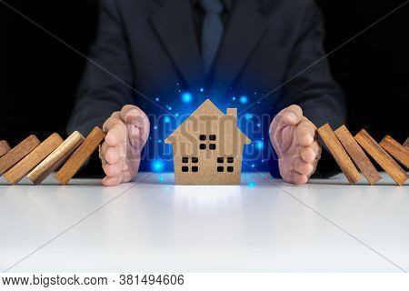 Insurance With Hands Protect A House. Home Insurance Or House Insurance Concept. The Hand Of A Busin