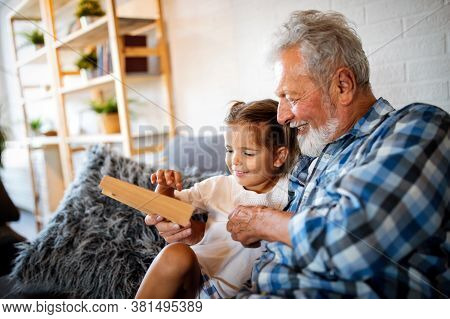 Grandparent Playing And Having Fun With Their Granddaughter