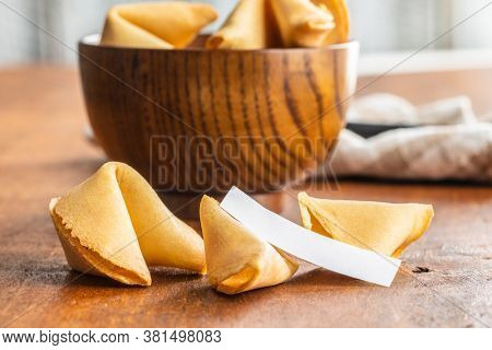 Chinese lucky cookies. Fortune cookies on wooden table.