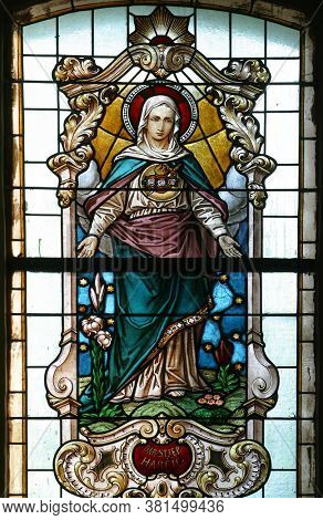 PESCENICA, CROATIA - SEPTEMBER 07, 2013: Immaculate Heart of Mary, stained glass window in Parish Church of the Assumption of the Virgin Mary in Pescenica, Croatia