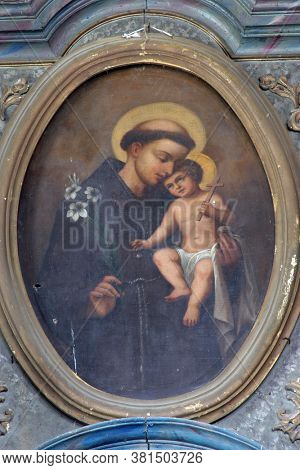 LIJEVI DUBROVCAK CROATIA - JULY 09, 2013: Saint Anthony of Padua holds the child Jesus, altar painting on the high altar in the parish church of Saint Martin in Lijeva Dubrovcak, Croatia