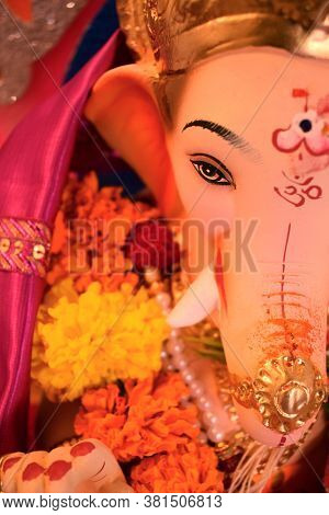 Abstract Background Of Lord Ganesha Beautiful Face & Eyes Close Up With Hindu Religion Om Sign Symbo