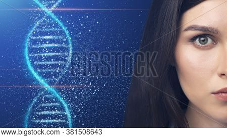 Genetics And Cosmetology Concept. Beautiful Young Woman With Perfect Skin And Dna Helix On Blue Back