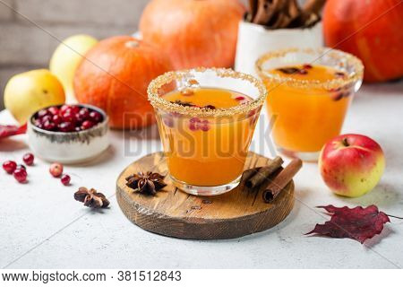 Hot Pumpkin Punch Or Sangria In A Glass With Apple, Cinnamon, Anise. Halloween And Thanksgiving. Tra
