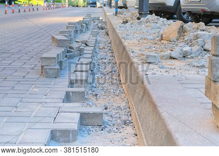 Repair Work In The Pedestrian Zone Of The Residential Complex. Engineering Works. Laying Of Paving S