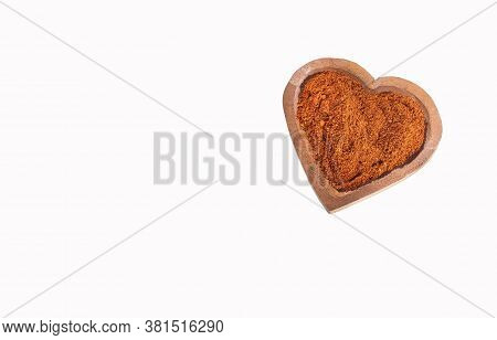 Organic Red Paprika Powder In Heart Shaped Bowl - Capsicum Annuum