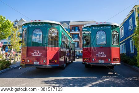 Bar Harbor, Maine - 28 August 2014: Oli's Trolleys are re-purposed trolley car that offer tourist tours around Mount Desert Island and Acadia national Park and are based in Bar Harbor, maine, USA.