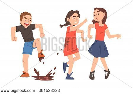 Bully Boy Jumping Into Puddle And Dirtying Girls With Mud, Mockery And Bullying At School Concept Ca
