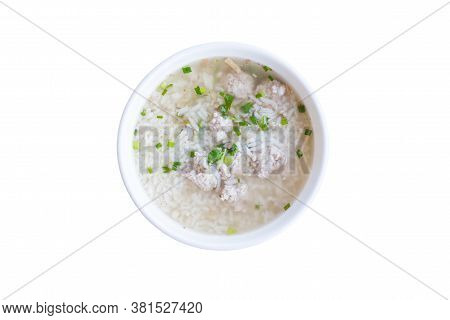 Delicious Porridge On Rice Bowl. Food Thai Style. Pork Rice Porridge Isolated On White Background.