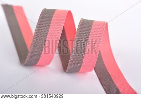 Pink And Gray Cotton Ribbon, Roll Textilies On Bobbin. Strapping Tape And Rope Lime Webbing With Cur