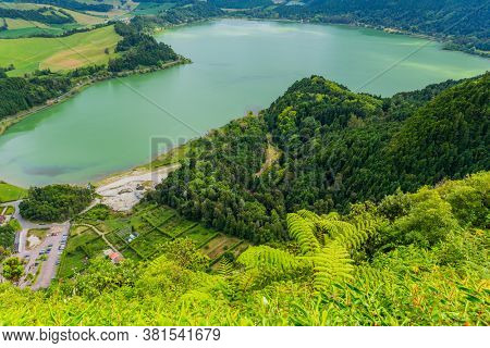 View of the Lake Furnas (Lagoa das Furnas) on Sao Miguel Island, Azores, Portugal from the Pico do Ferro scenic viewpoint. Tranquil scene of lush foliage and lake in a volcanic crater