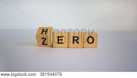 From Zero To Hero Concept. Hand Turns A Cube And Changes The Word 'zero' To 'hero'. Beautiful White